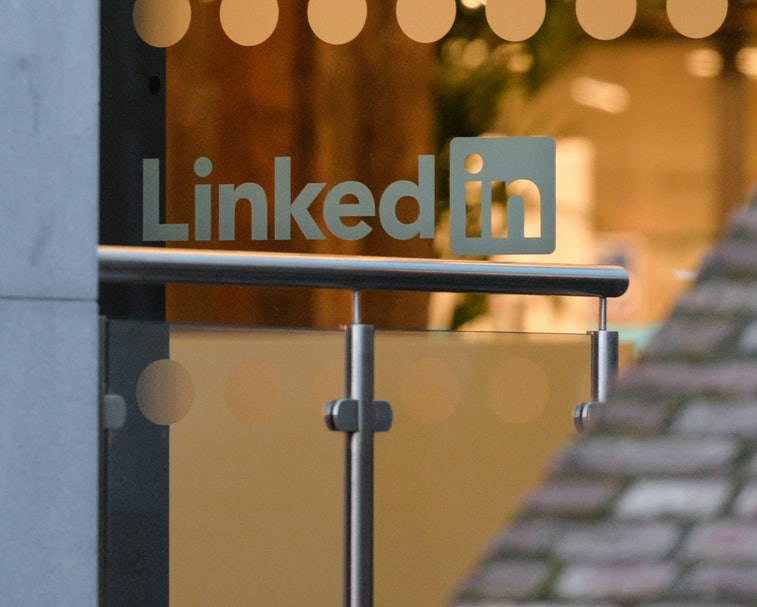 LinkedIn logo on a glass office door.