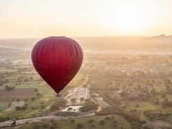 hot air balloon floating over a big field, meant to represent the author's ectopic kidney