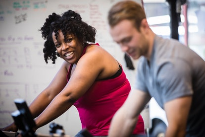 woman and man at spin class