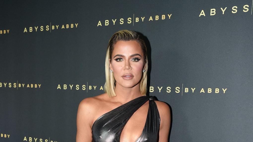 Khloe Kardashian hits the red carpet in a metallic dress.