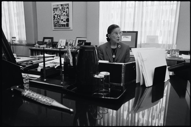 Ruth Bader Ginsburg sits at her desk.
