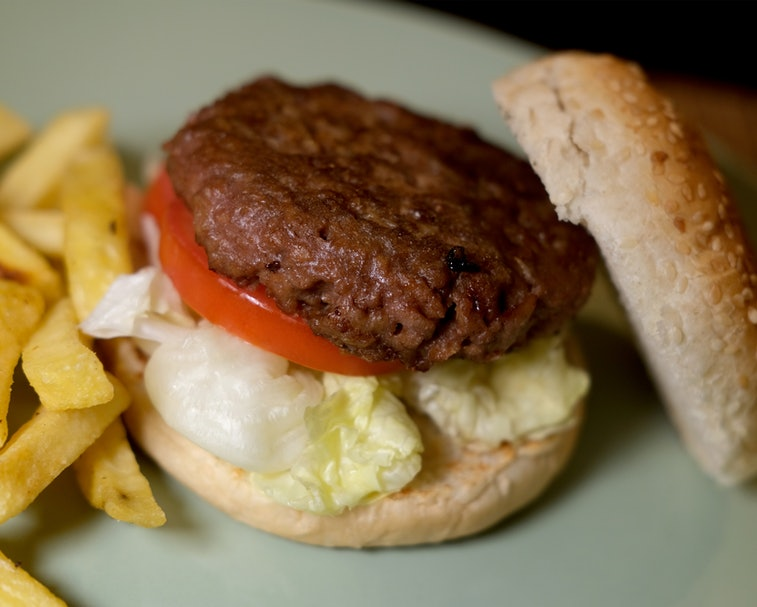 A plant-based burger by Beyond Meat is seen on a plate.