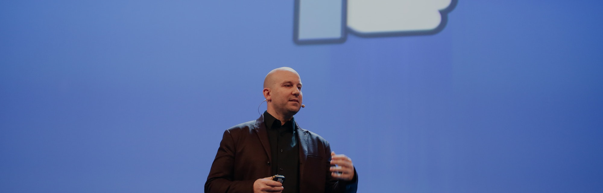 Facebook executive Andrew Bosworth speaking on stage.
