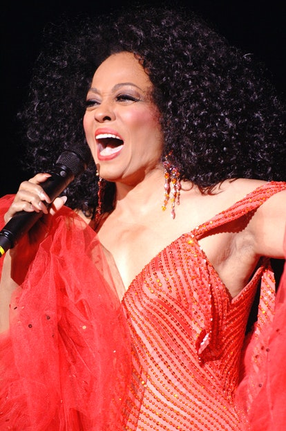 Diana Ross sings in a red ballgown.