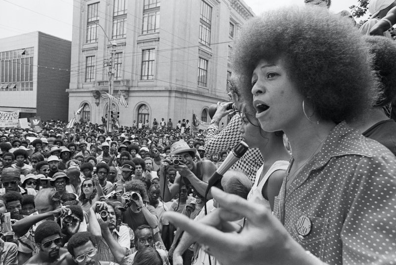 Angela Davis gives a speech. These 20 inspiring quotes from Black women can help celebrate Black History Month.