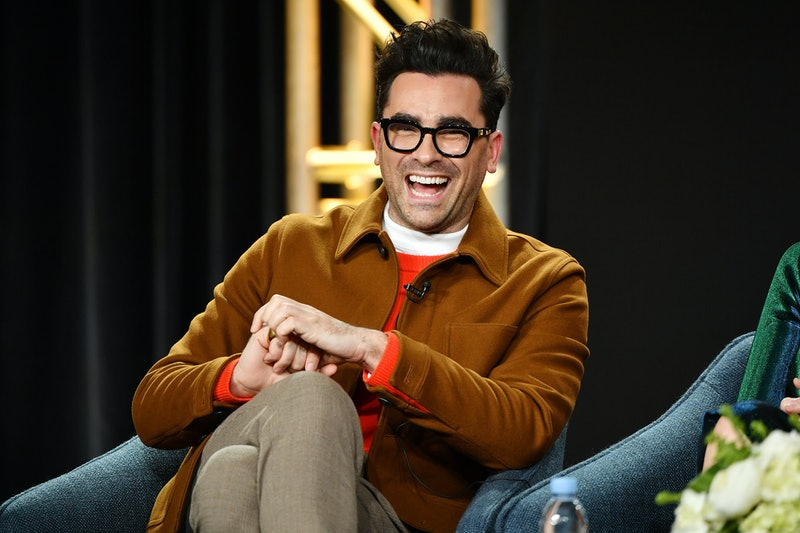 Dan Levy laughing. Photo via Getty Images