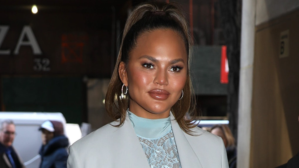Chrissy Teigen steps out with her daughter Luna.