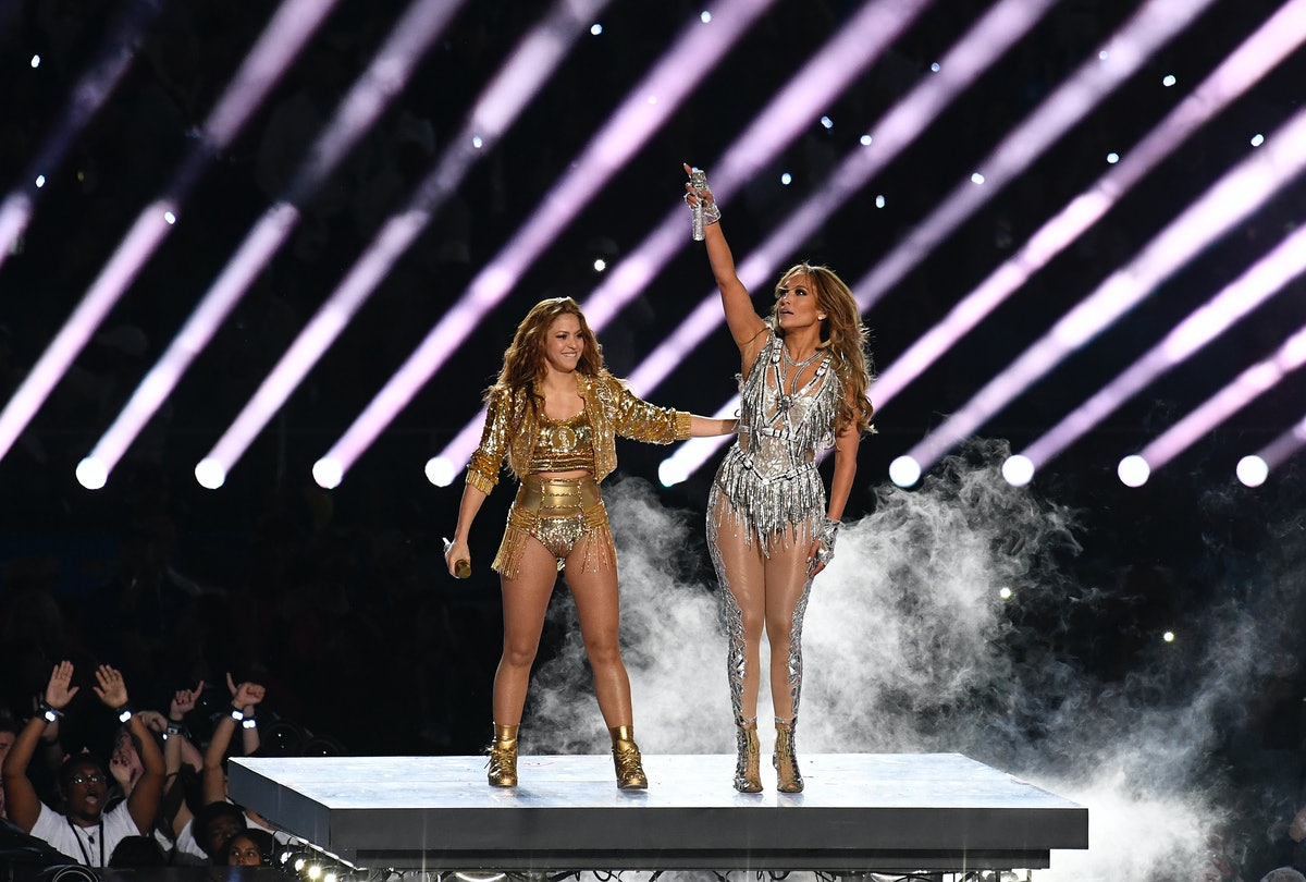 Shakira and Jennifer Lopez dance and interact with the crowd during the Super Bowl 2020 halftime sho...