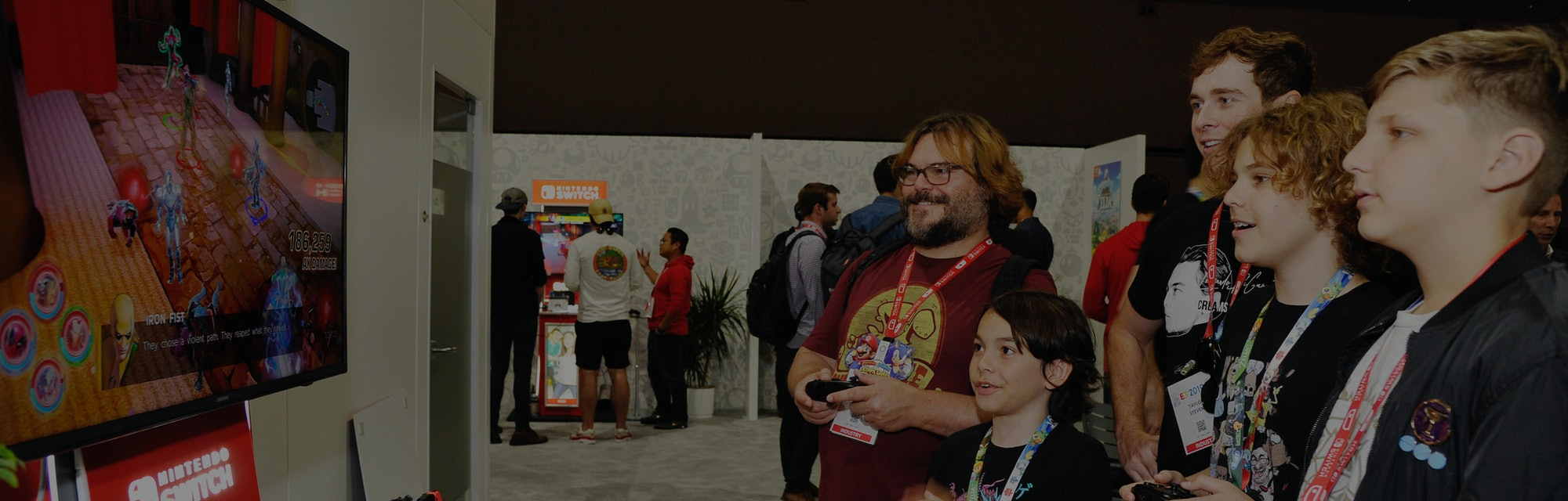 Actor Jack Black playing video games with attendees of the E3 gaming expo.