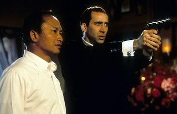 Director John Woo and Nicolas Cage
