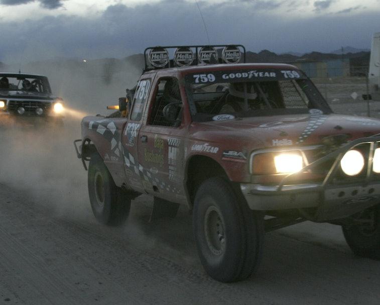 Pickup trucks racing at San Felipe 250 in Baja, California.
