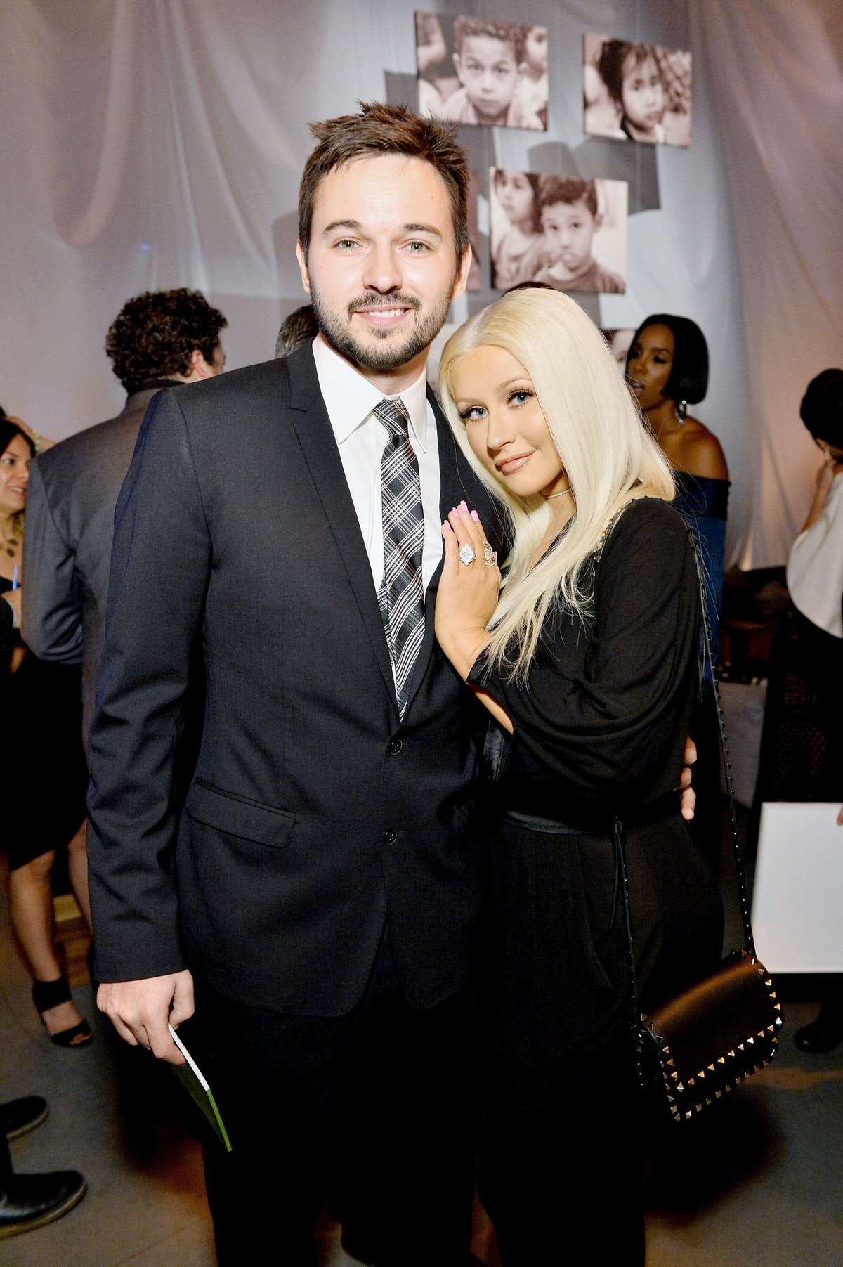 CULVER CITY, CA - NOVEMBER 12: Matthew Rutler (L) and recording artist Christina Aguilera attend the...