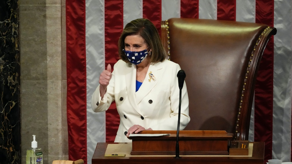 WASHINGTON, DC - MARCH 10: Speaker of the House Nancy Pelosi (D-CA) gives a thumbs up as she presides over voting on coronavirus relief package H.R. 1319 in the House Chamber of the U.S. Capitol on March 10, 2021 in Washington, DC. In a final vote, the House passed U.S. President Joe Biden's revised $1.9 trillion COVID-19 relief bill, named the American Rescue Plan, in the administration's first major legislative achievement. (Photo by Drew Angerer/Getty Images)
