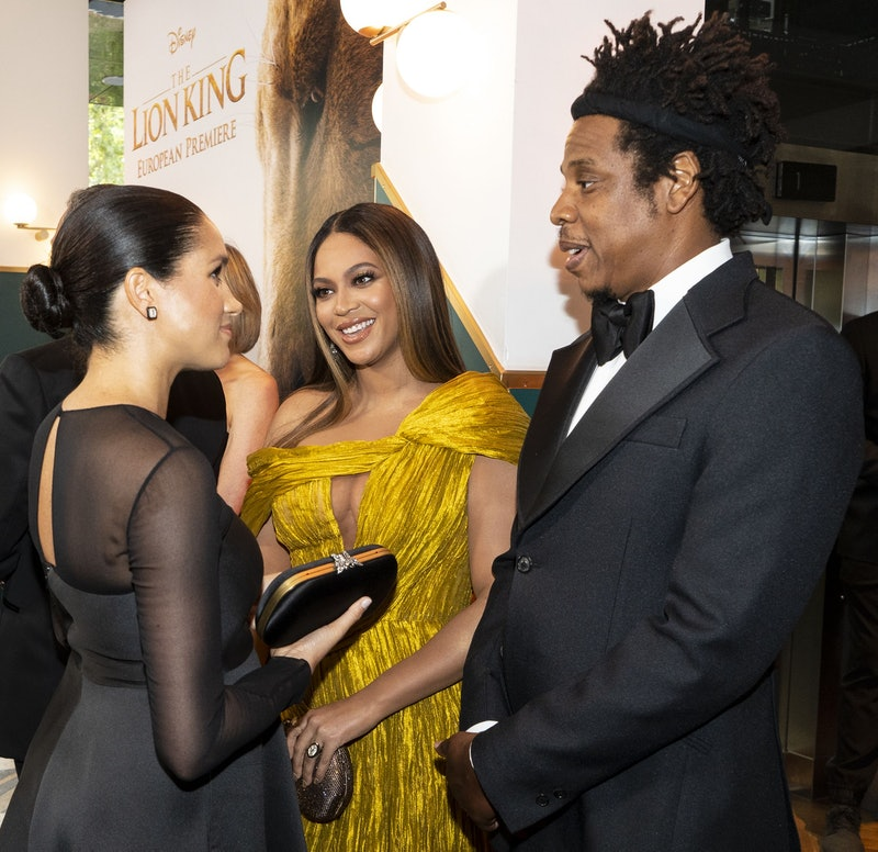 Britain's Meghan, Duchess of Sussex (L) meets cast and crew, including US singer-songwriter Beyoncé (C) and her husband, US rapper Jay-Z (R) as she attends the European premiere of the film The Lion King in London on July 14, 2019. (Photo by Niklas HALLE'N / POOL / AFP)        (Photo credit should read NIKLAS HALLE'N/AFP via Getty Images)