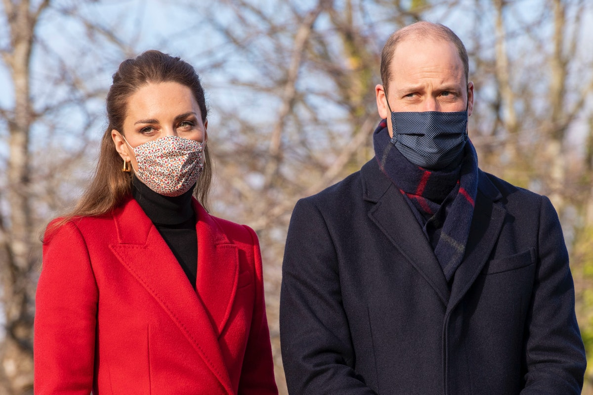 Wearing a protective face covering to combat the spread of the coronavirus, Britain's Catherine, Duc...