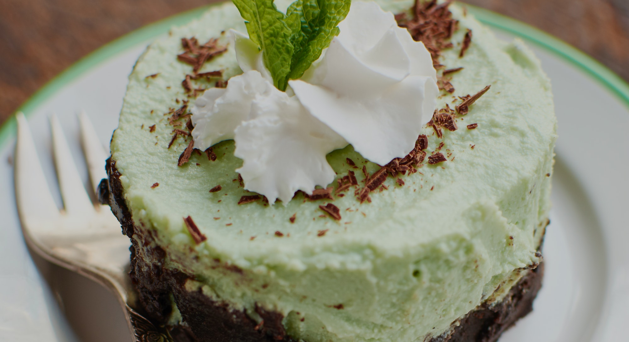Use green food coloring to make frosting for a cake.