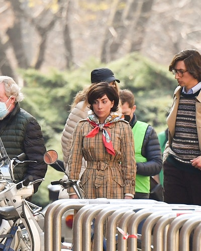 """MILAN, ITALY - MARCH 10:  Director Ridley Scott, Lady Gaga and Adam Driver are seen filming """"House of Gucci"""" movie  on March 10, 2021 in Milan, Italy. (Photo by Photopix/GC Images)"""