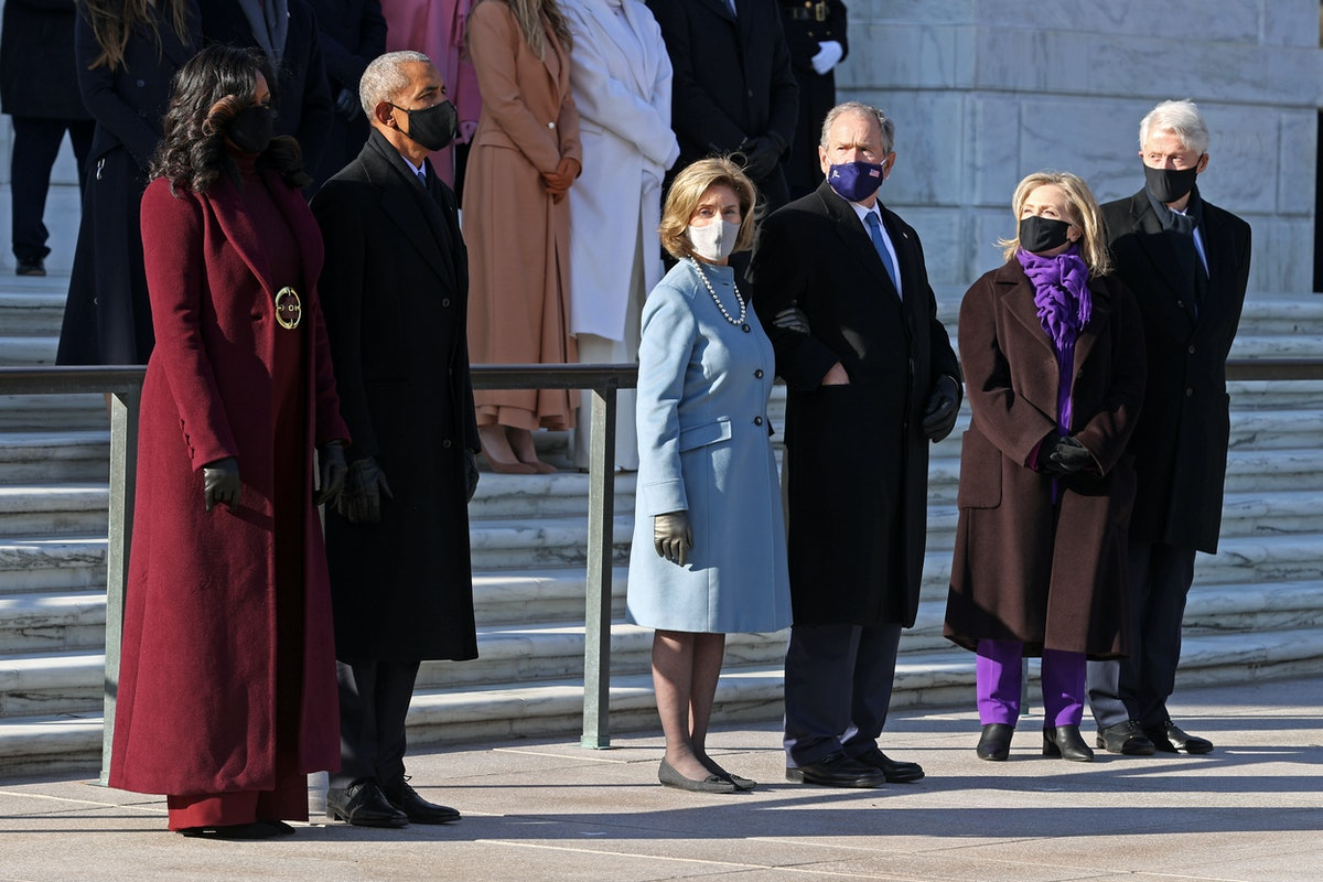 ARLINGTON, VA - JANUARY 20: Former U.S. President Barack Obama, Michelle Obama, and former U.S. President George W. Bush and Laura Bush, and former U.S. President Bill Clinton and former Secretary of State Hillary Clinton attend a wreath-laying ceremony at the Tomb of the Unknown Soldier after the President Joe Biden's Presidential Inauguration at the U.S. Capitol January 20, 2021 at Arlington National Cemetery in Arlington, Virginia. During today's inauguration ceremony Joe Biden becomes the 46th president of the United States. (Photo by Chip Somodevilla/Getty Images)