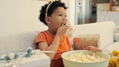 Eating popcorn is not a safe toddler snack.