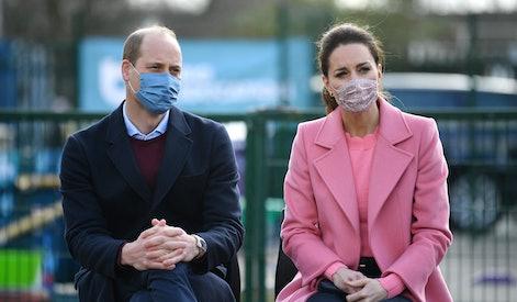 Britain's Prince William, Duke of Cambridge  and Britain's Catherine, Duchess of Cambridge listen du...