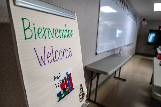Carrizo Springs, TX- FEB 21: A welcome sign on display inside a classroom at a Influx Care Facility (ICF) for unaccompanied children on Sunday, Feb. 21, 2021 in Carrizo Springs, TX. Children will begin arriving Monday before being placed with a government approved sponsor. The facility has dorm like rooms with areas for eating, bathing, and even hair cuts and laundry. (Sergio Flores/The Washington Post via Getty Images)