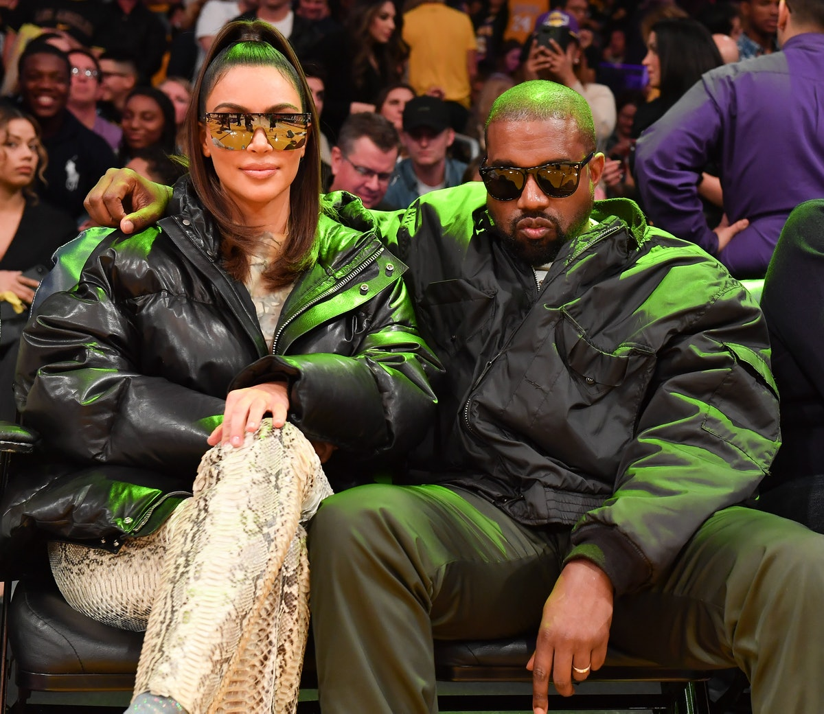 LOS ANGELES, CALIFORNIA - JANUARY 13: Kim Kardashian and Kanye West attend a basketball game between...