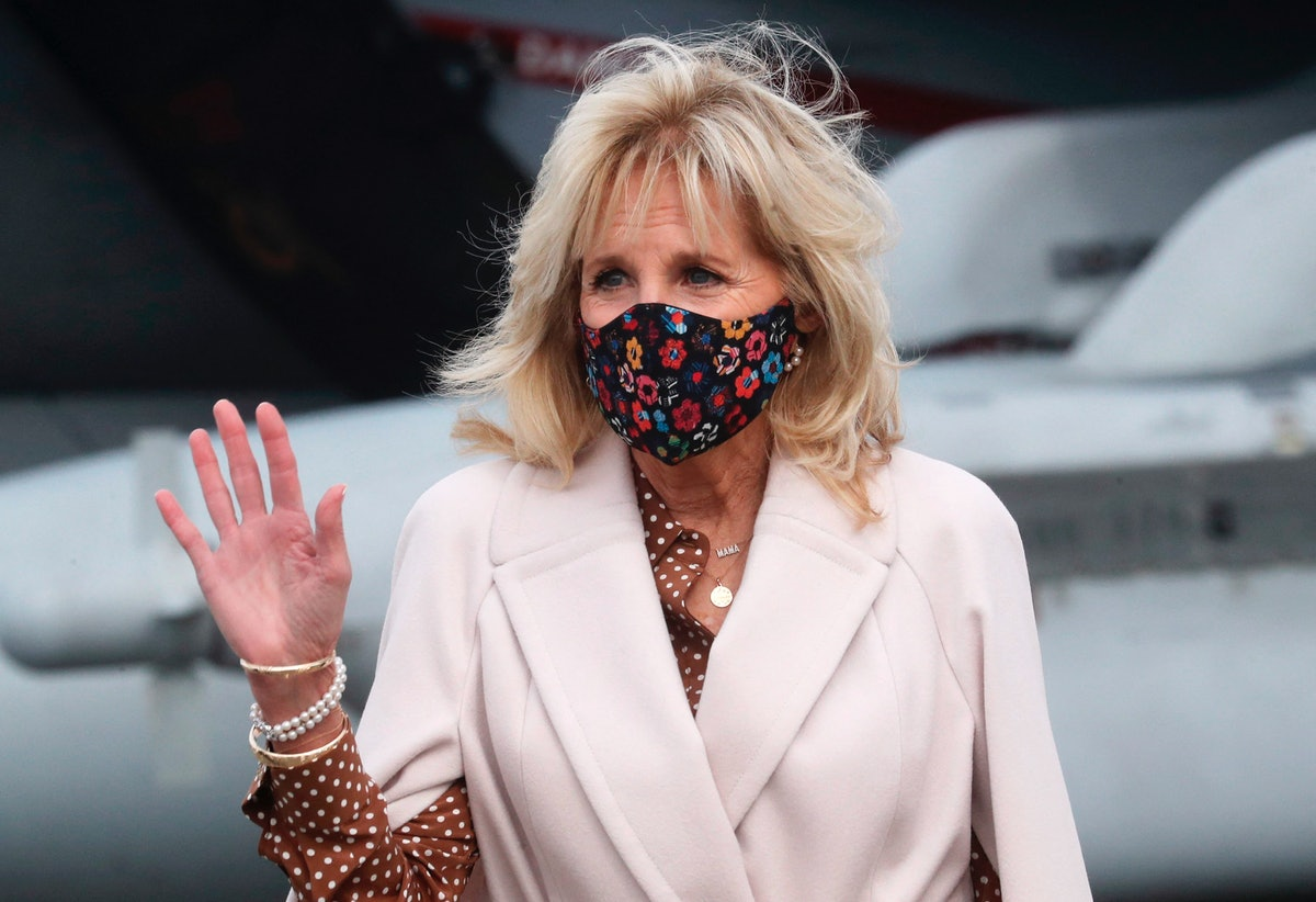 US First Lady Jill Biden waves as she is given a tour of Growler aircraft, March 9, 2021, at Naval A...