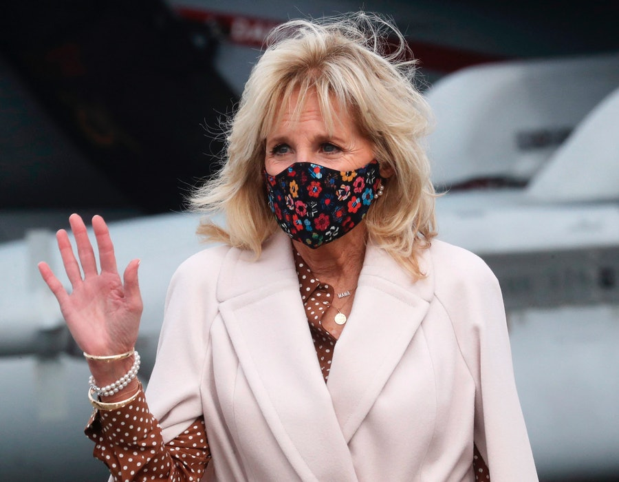 US First Lady Jill Biden waves as she is given a tour of Growler aircraft, March 9, 2021, at Naval Air Station Whidbey Island in Oak Harbor, Washington. (Photo by Ken LAMBERT / POOL / AFP) (Photo by KEN LAMBERT/POOL/AFP via Getty Images)