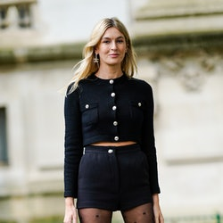 PARIS, FRANCE - OCTOBER 06: Camille Charriere wears a black cardigan with buttons, black shorts, Cha...
