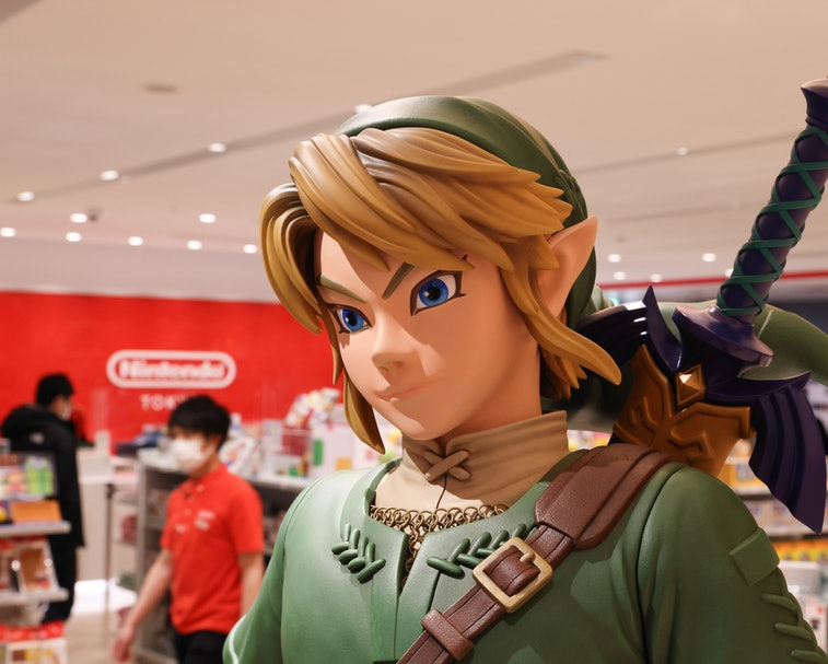 Link figurine from Legend of Zelda with shop staff inside Nintendo Tokyo store in Shibuya. (Photo by Stanislav Kogiku/SOPA Images/LightRocket via Getty Images)
