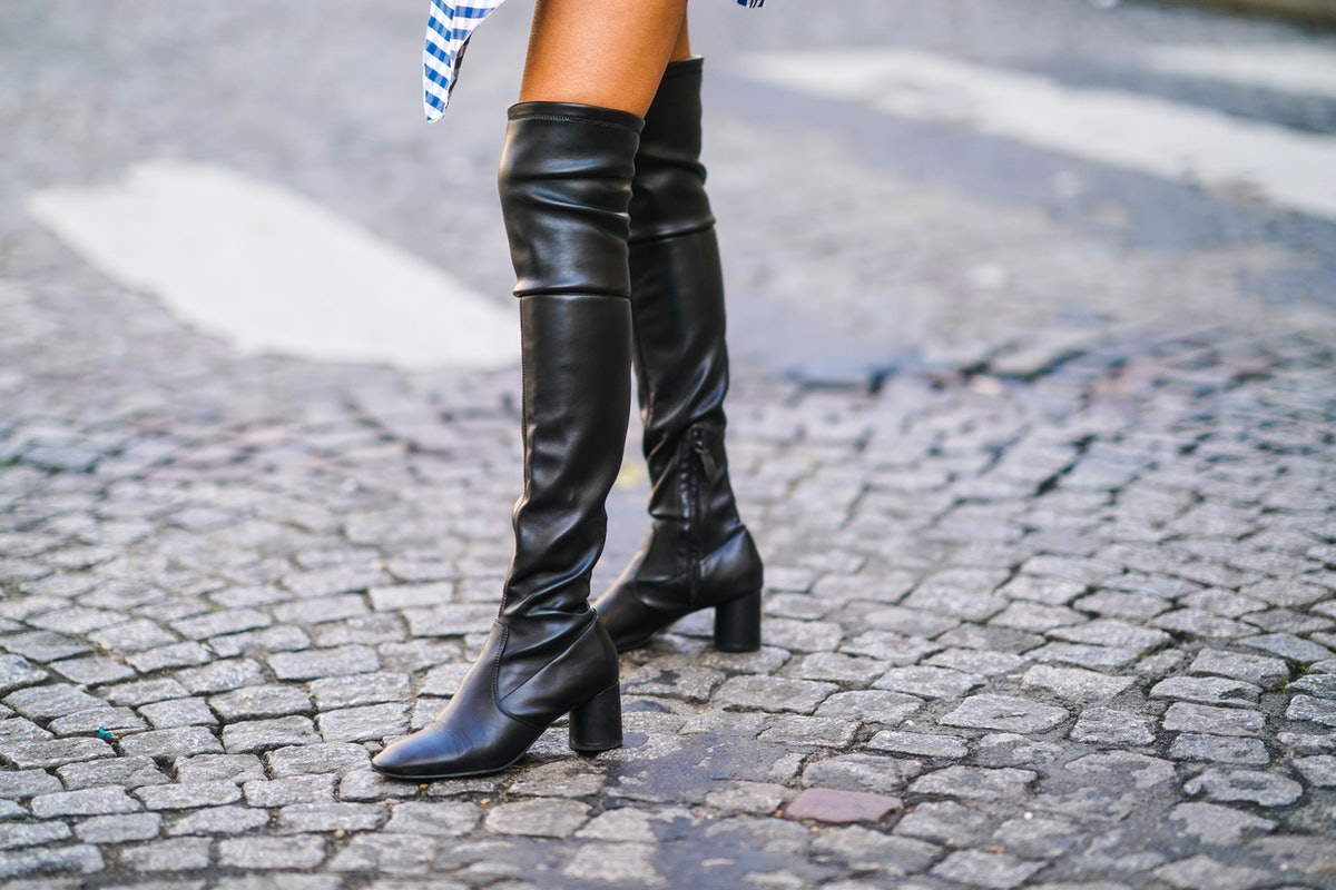 PARIS, FRANCE - FEBRUARY 23: Adriana Seminario wears thigh high leather black pointy boots from Mi/Mai with high heels, on February 23, 2021 in Paris, France. (Photo by Edward Berthelot/Getty Images)