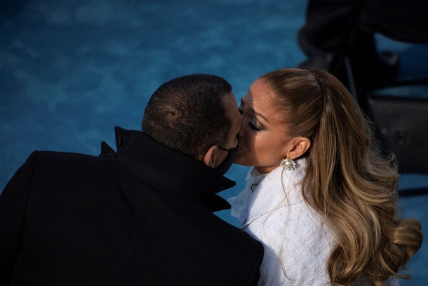 Jennifer Lopez (R) kisses fiancé Alex Rodriguez (L) after performing during the inauguration of Joe Biden as the 46th US President on January 20, 2021, at the US Capitol in Washington, DC. (Photo by Caroline Brehman / POOL / AFP) (Photo by CAROLINE BREHMAN/POOL/AFP via Getty Images)