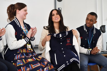 LONDON, ENGLAND - MARCH 06: Meghan, Duchess of Sussex smiles after being gifted a jacket from the 'S...