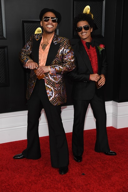 Anderson .Paak wearing a Gucci suit with Bruno Mars at the 2021 Grammys.