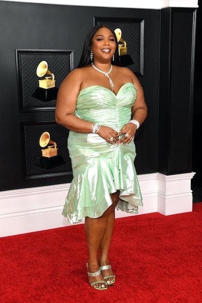 Lizzo wearing a custom Balmain mini dress to the 2021 Grammys.