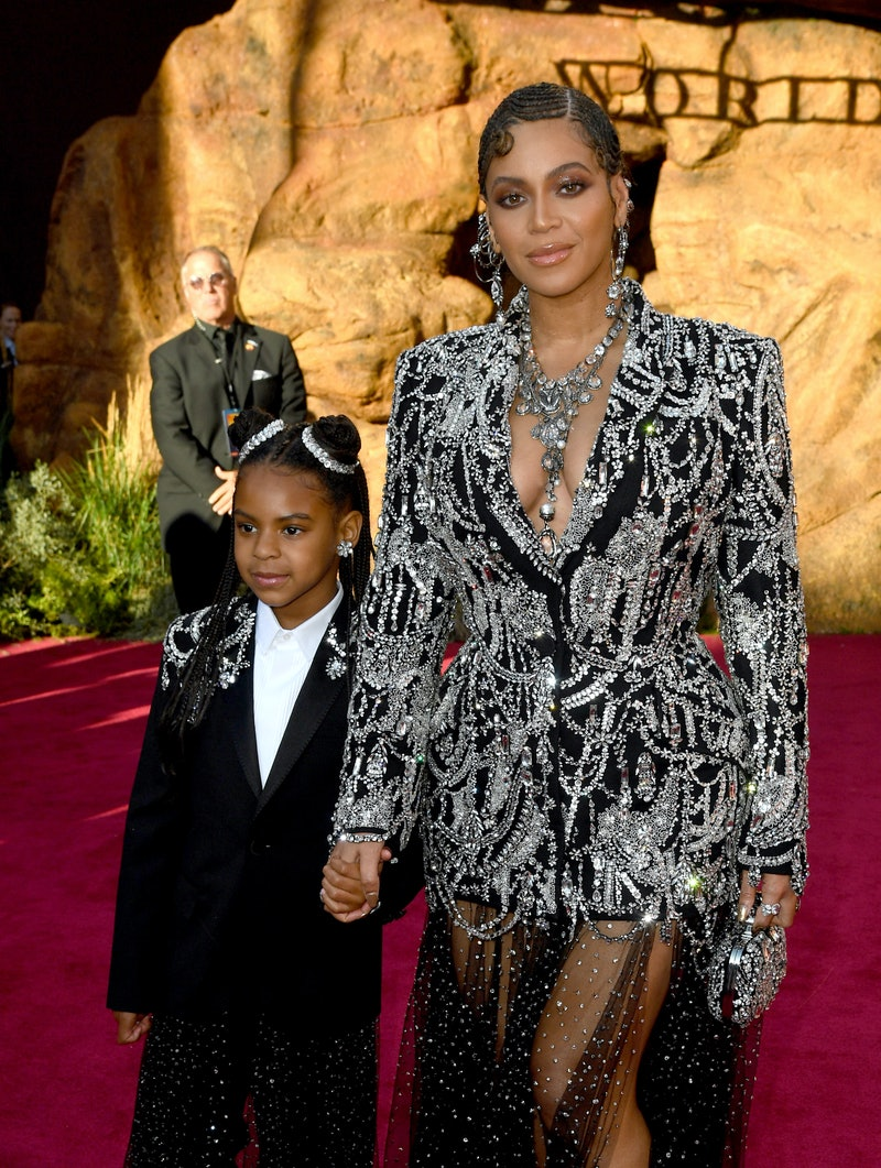 """HOLLYWOOD, CALIFORNIA - JULY 09: (L-R) Blue Ivy Carter and Beyoncé attends the premiere of Disney's """"The Lion King"""" at Dolby Theatre on July 09, 2019 in Hollywood, California. (Photo by Kevin Winter/Getty Images)"""