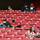 Fans are seen on the stands of the Akron stadium before the start of the Mexican Clausura football tournament match between Guadalajara and America -the Super Clasico- to which spectators are allowed in with the implementation of safety protocols and up to 25% of the stadium's capacity amid the COVID-19 novel coronavirus pandemic, on March 14, 2021, in Guadalajara, Jalisco State, Mexico. (Photo by Ulises RUIZ / AFP) (Photo by ULISES RUIZ/AFP via Getty Images)