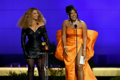 LOS ANGELES, CALIFORNIA - MARCH 14: (L-R) Beyoncé and Megan Thee Stallion accept the Best Rap Performance award for 'Savage' onstage during the 63rd Annual GRAMMY Awards at Los Angeles Convention Center on March 14, 2021 in Los Angeles, California. (Photo by Kevin Winter/Getty Images for The Recording Academy)