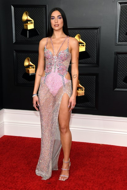 Dua Lipa wearing an embellished Versace gown to the 2021 Grammys.