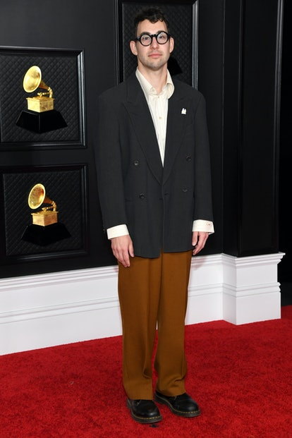 Jack Antonoff wore a black suit jacket and brown trousers to the 2021 Grammys.