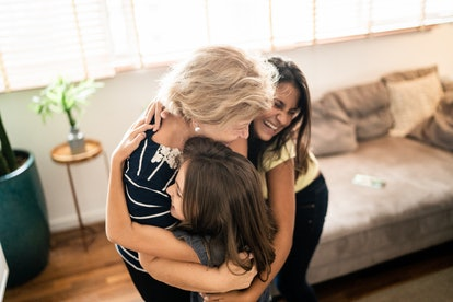 mom and daughters hug on mother's day