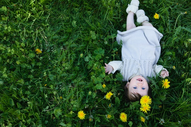baby in daises