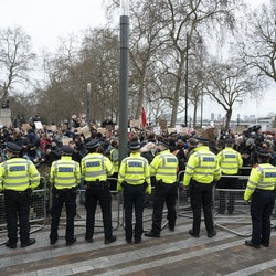 LONDON, UNITED KINGDOM - MARCH 14: Police take measures as mourners for the life of murdered 33-year-old Sarah Everard, whose remains were found this week in woodland in Kent, take part in a demonstration organised by group Sisters Uncut outside New Scotland Yard in London, United Kingdom on March, 14, 2021. Wayne Couzens, a serving Metropolitan Police officer, has been charged with the kidnap and murder of Everard, who went missing over a week ago from south London and whose disappearance and death has seen women across the country speaking up about their own fears of not being safe on the streets. (Photo by Ray Tang/Anadolu Agency via Getty Images)