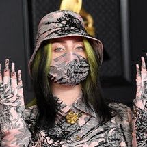 Billie Eilish's Grammy's look was a tiger print set that matched her nails and face mask.