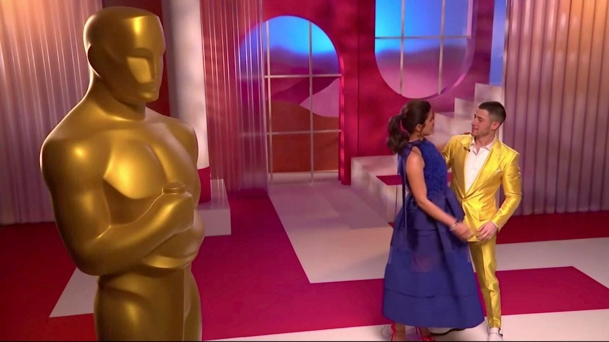 Priyanka Chopra Jonas and Nick Jonas embrace at the 93rd Academy Awards Nominations Announcement on...