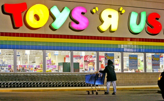 1/6/06 - BOSTON, MA  -  A shopper passes in front of Toys R Us in the South Bay Shopping Plaza Friday.  (010606toydg- Staff Photo by David Goldman. Saved in Photo SATURDAY) (Photo by David Goldman/MediaNews Group/Boston Herald via Getty Images)