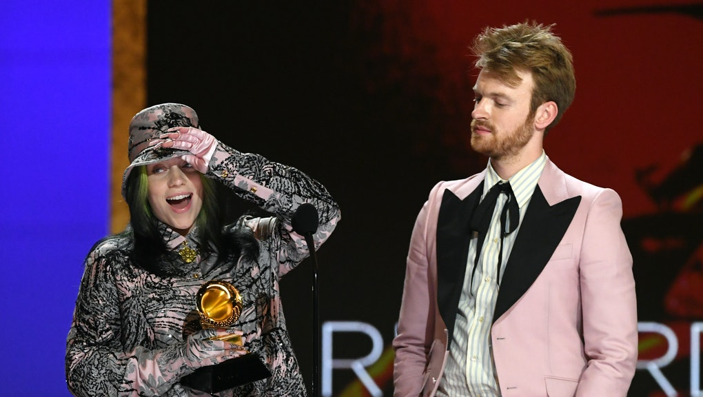 LOS ANGELES, CALIFORNIA - MARCH 14: (L-R) Billie Eilish and FINNEAS accept the Record of the Year aw...