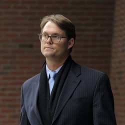 Mark Riddell leaves the John Joseph Moakley United States Courthouse after pleading guilty in the co...