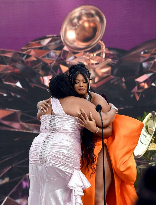 LOS ANGELES, CALIFORNIA - MARCH 14: Lizzo presents the Best New Artist award to Megan Thee Stallion onstage during the 63rd Annual GRAMMY Awards at Los Angeles Convention Center on March 14, 2021 in Los Angeles, California. (Photo by Kevin Winter/Getty Images for The Recording Academy)