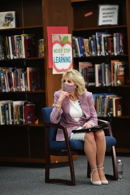US First Lady Jill Biden listens to parents as she tours Fort LeBoeuf Middle School in Waterford, Pennsylvania, on March 3, 2021. (Photo by MANDEL NGAN / POOL / AFP) (Photo by MANDEL NGAN/POOL/AFP via Getty Images)